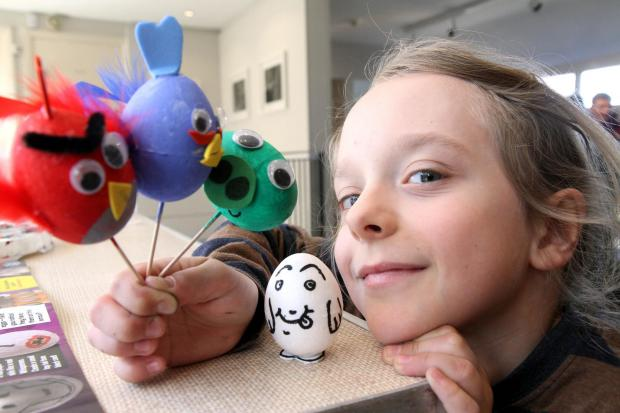 Nine-year-old Titus Buta shows off some of the creations from the Bronte Parsonage Easter egg event in Haworth