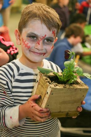 Six-year-old Tyler Lister with his plant-holder at the Sue Belcher Centre Earth Day