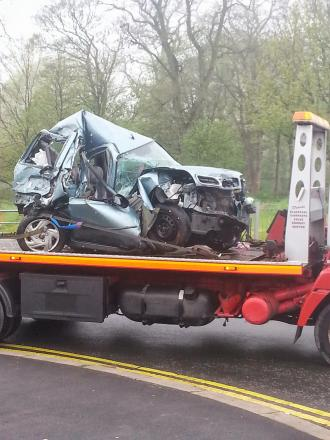 The remains of a Nissan Micra crushed by the lorry