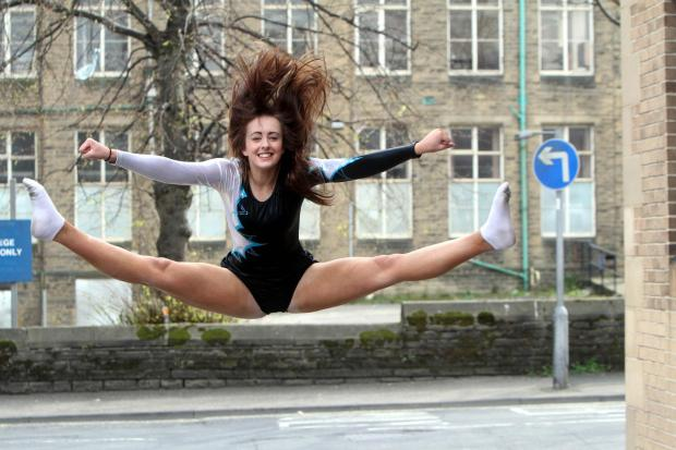 Keighley cheerleader Siân Reid jumps for joy after her latest competition success during an event at Disneyland Paris
