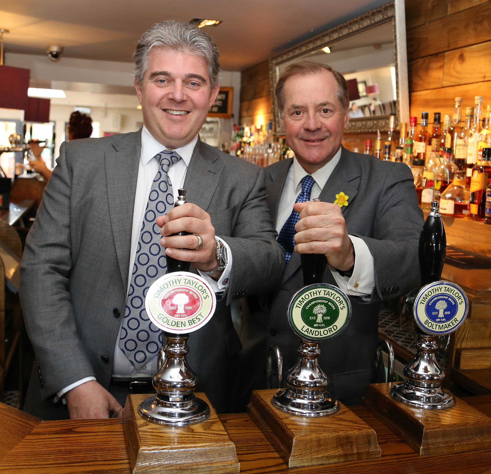 Brandon Lewis, left, and Timothy Taylor's managing director, Charles Dent, at the Lord Rodney in Keighley