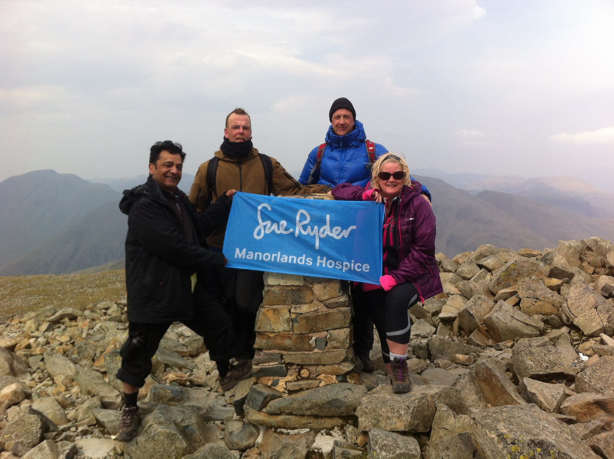 The Pike & Paddle team, from left, Jawaid Iqbal, Iain Nutter, Ev Pritchard and Jayne Harris, on Scafell Pike