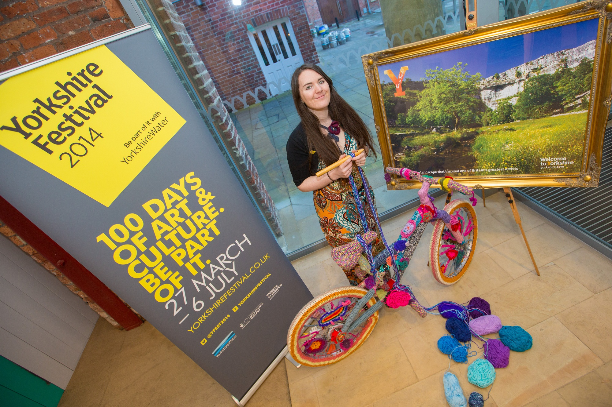 Artist Cassandra Kilbride with one of the knitted bikes, which will form the central focus of a workshop in Haworth