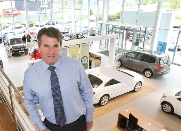 Keighley News: White Rose VW owner Frank Greenway unveils the new £500,000 refurbishment to the Cross Hills showroom and service areas