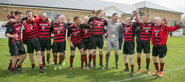 Keighley Town celebrate their cup success. Picture: David Brett