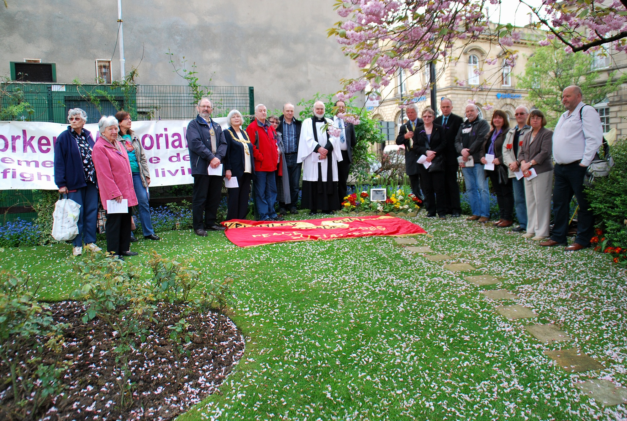 People gathered at the Workers' Memorial Day event, which was held at the Town Hall Square in Keighley for people to remember employees killed in their place of work