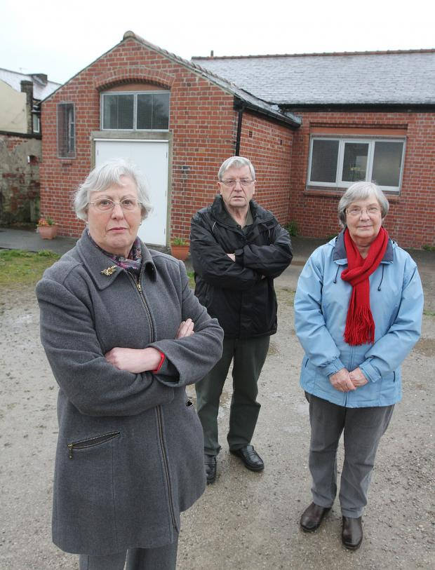 Keighley News: Members of the congregation at St Joseph's Church in Cross Hills, from left, Mary Askew and Gerry and Joan Griffin, protesting about the plan