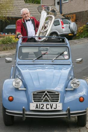 Dennis Renshaw two of the main loves in his life – his tuba and his Citroen CV car