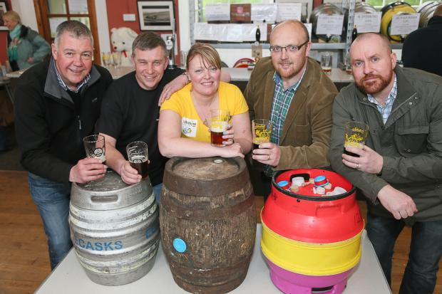 Simon Lamb and Ian Cowling, of Bridgehouse Brewery, event organiser Kathryn Thornton, plus Jon Crossley and Steven Burles, of Airedale Aspire Network, enjoy a pint at Haworth Beer Festival Pictures by David Brett