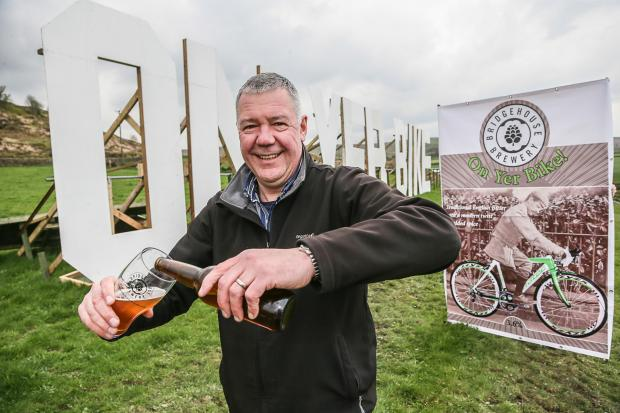 Bridgehouse Brewery sales and marketing director Simon Lamb by the On Yer Bike clip and the beer and giant pump clip of the same name