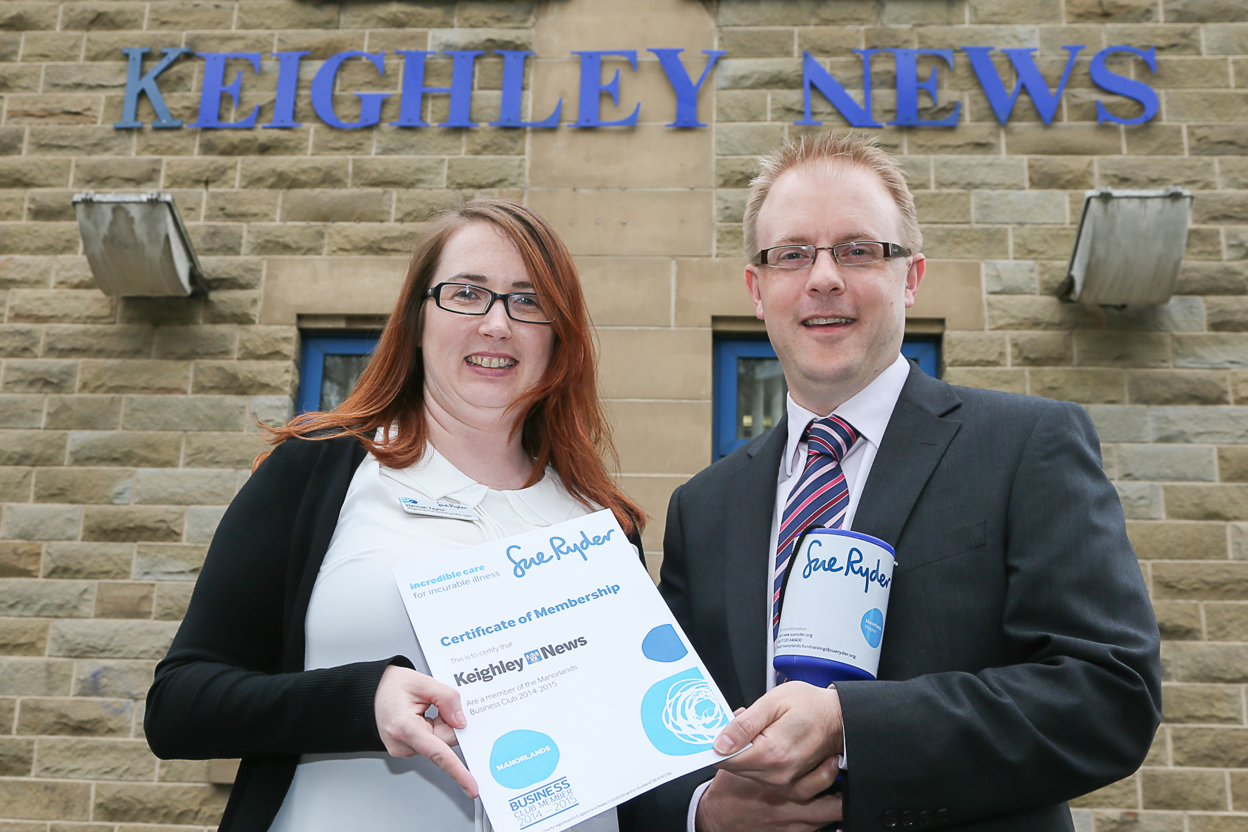 Sue Ryder regional fundraising manager, Hannah Taylor, presents Keighley News editor Richard Parker with the first membership certificate for the Manorlands Business Club