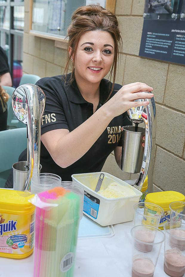 Keighley News: Travel and tourism student Olivia Sutcliffe preparing the ice creams