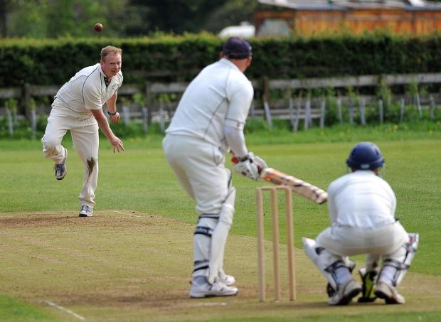 Keighley News: Jonny Moore bowling for Olicanians' seconds against Steeton