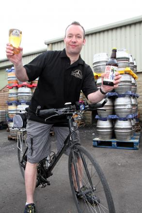 Brewer David Smith with the special ale produced for the Tour de France by Naylor's Brewery in Cross Hills