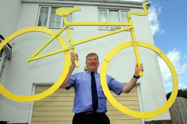 Keighley MP Kris Hopkins with the wooden bike he has made to attach to his Haworth house as part of celebrations to welcome the Tour de France Grand Depart to the village