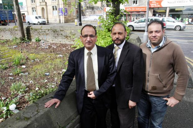 Councillors Khadim Hussain, left, and Abid Hussain with by Crown Private Hire driver Gulfraz Hussain at the disused former Keighley College car park