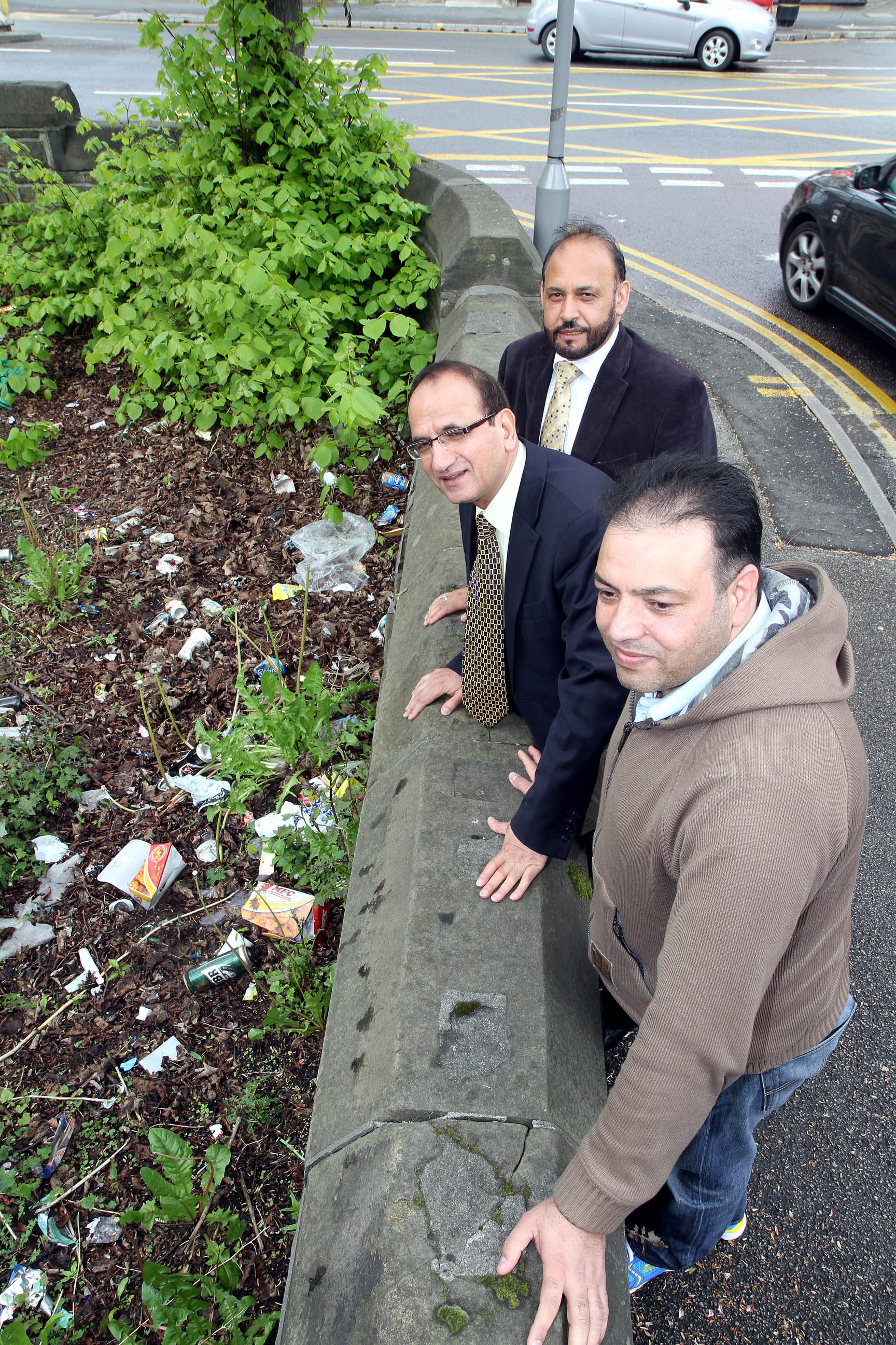 Councillors Abid Hussain, top, and Khadim Hussain with Crown Private Hire driver, Gulfraz Hussain, front, inspecting litter at the former Keighley College car park