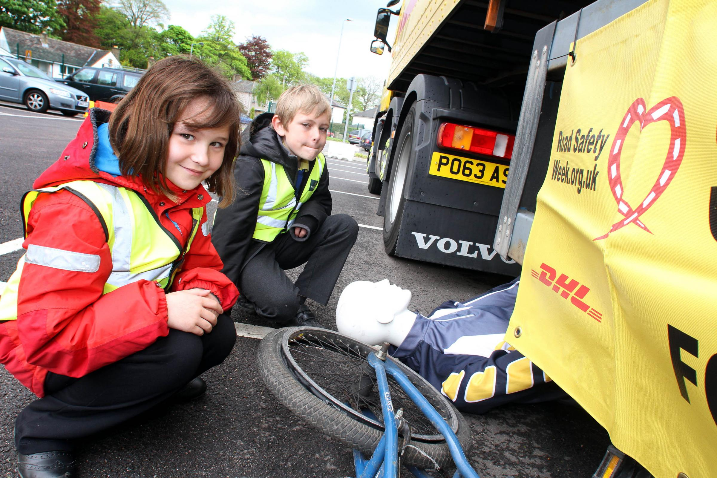 Haworth Primary School pupils Elke Timlin-Bates and Jack Muir get a safety lesson during the visit of the articulated lorries to University Academy Keighley