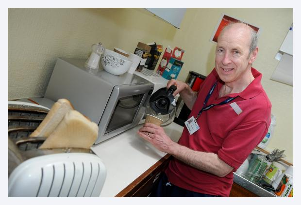 Airedale Hospital A&E housekeeper, Bob Tallon, serving up tea and toast to patients