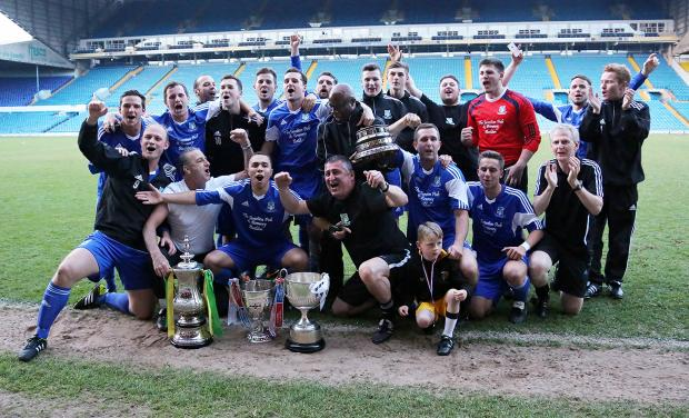 Keighley News: TRIPLE: Field parade their trophies after winning the County Cup Picture: Alex Daniel