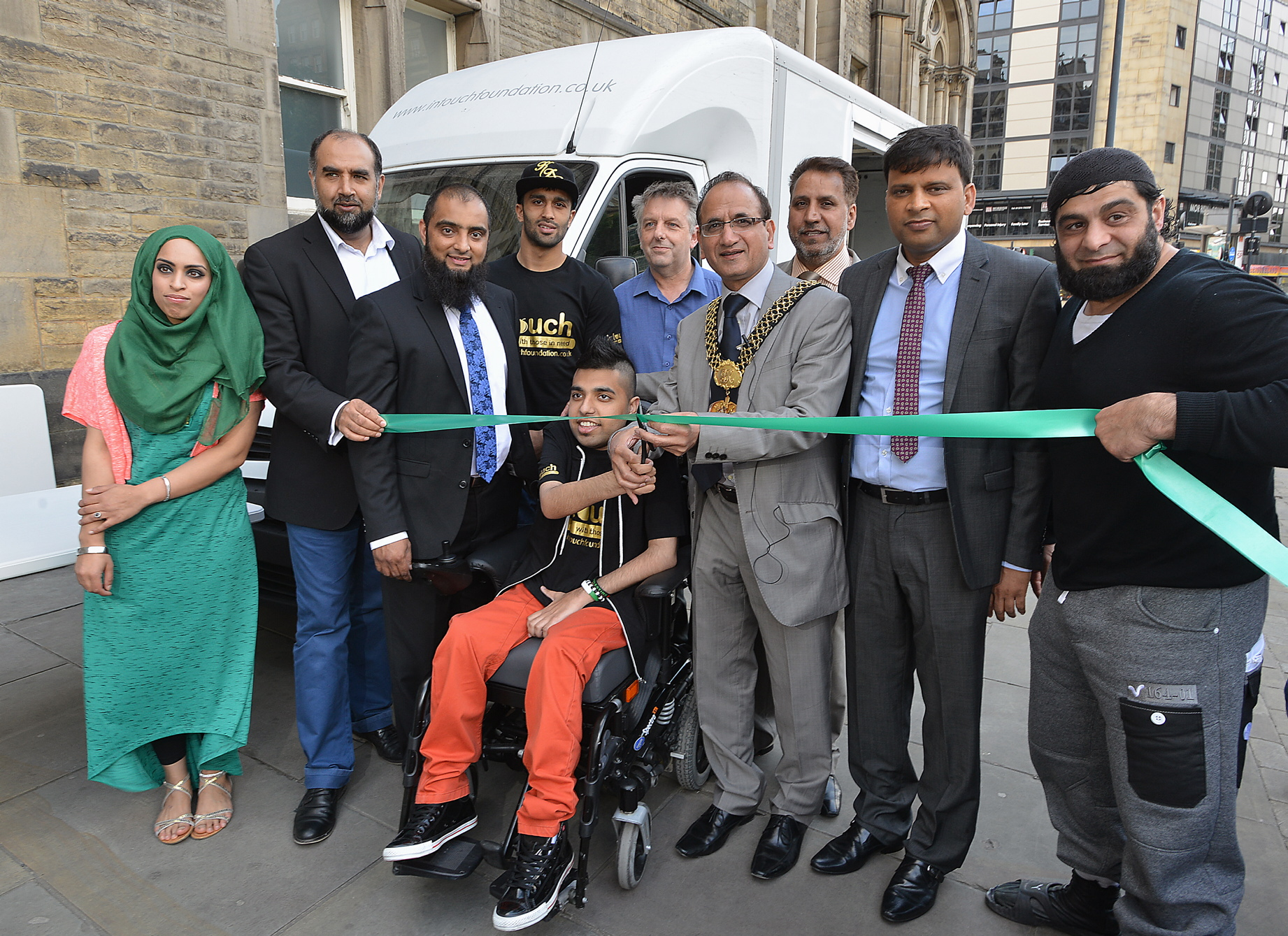 Lord Mayor of Bradford, Keighley councillor Khadim Hussain, cuts the ribbon to officially unveil the Intouch Foundation's new soup kitchen, which will serve both towns