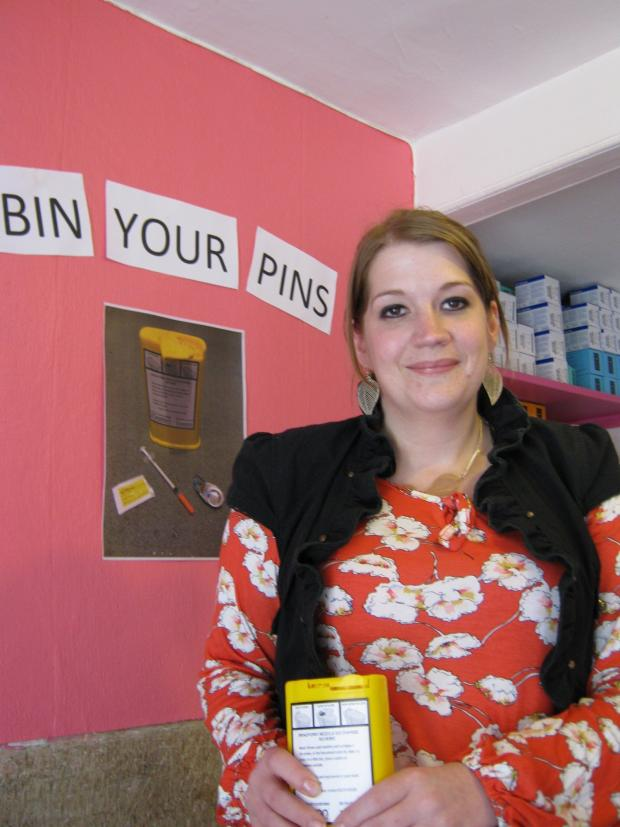 Keighley News: Project 6 worker, Ellie McNeil, promoting the 'Bin Your Pin' campaign among its clients