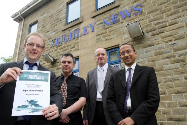 Keighley News editor Richard Parker, left, shows off the award certificate with editorial staff, from left, David Knights, Alistair Shand and Miran Rahman