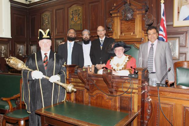 Mace bearer Barry Smith, Councillor Amjid Ahmed, Keighley resident Tufail Farooqi, new deputy mayor Councillor Javaid Akhtar, new mayor Councillor Graham Mitchell and Councillor Shabbir Ahmed during the official service last Thursday to confirm the dignit