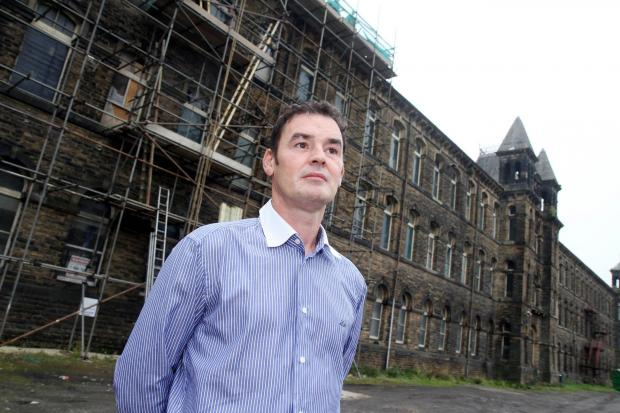 Dalton Mills owner Paul Harris outside the iconic building in Keighley