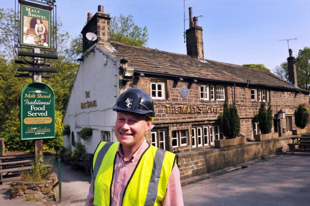 Keighley News: l Neil Pickles, of Pickles Pubs, outside the Malt Shovel in Harden, which is undergoing a £375,000 refurbishment