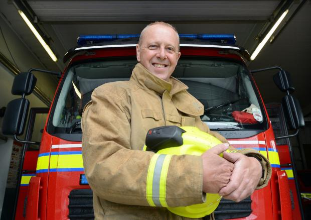 Keighley News: Firefighter Martin Shaw, from Silsden, who is retiring from his full-time post with the service after 25 years in the job
