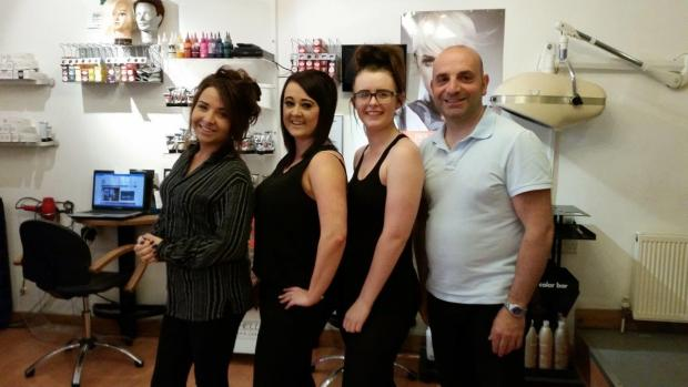 Hair Company staff, from left, Nadine Ward, Amber Taylor and Ruby Henson with owner Tony Palermo at the fundraising event