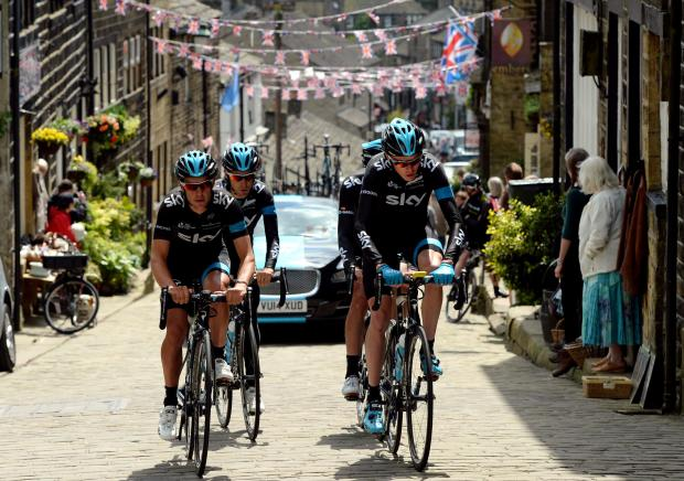 Keighley News: Tour de France riders in nearby Main Street