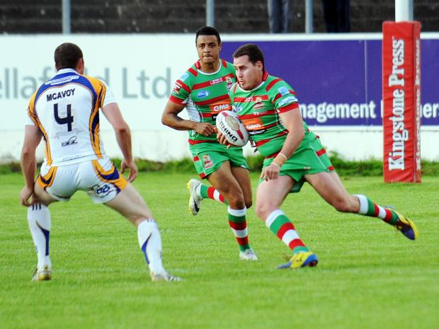 Keighley News: Brendon Rawlins goes on the charge for Cougars against Whitehaven. Pictures: Mike McKenzie