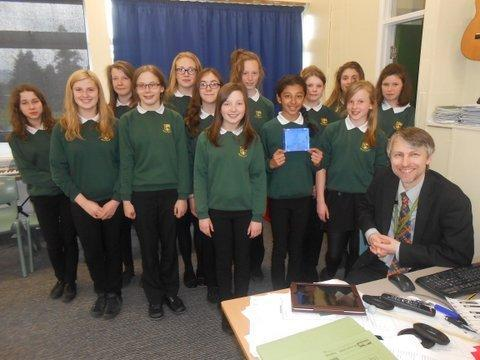 South Craven School pupils, with their new CD, and music teacher Tim Rossell (submitted pic)