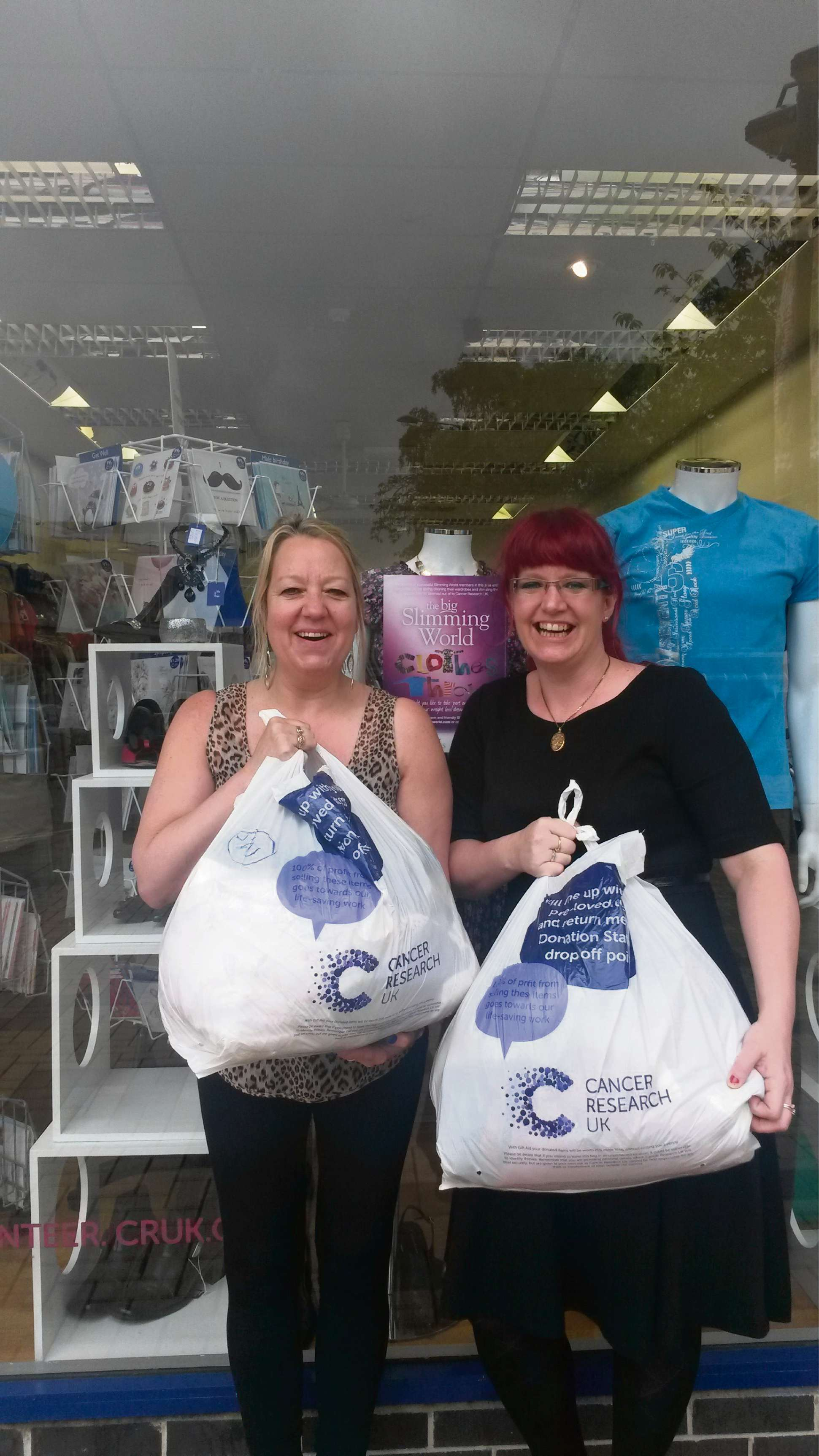 Jeanette Boyle, left, of Cancer Research UK, and Slimming World consultant Carla Weatherill with some of the donated clothes
