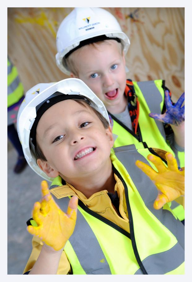 Keighley News: Sam Cheung and Brandon Howie have fun at the site of the new Airedale Hospital Emergency Department