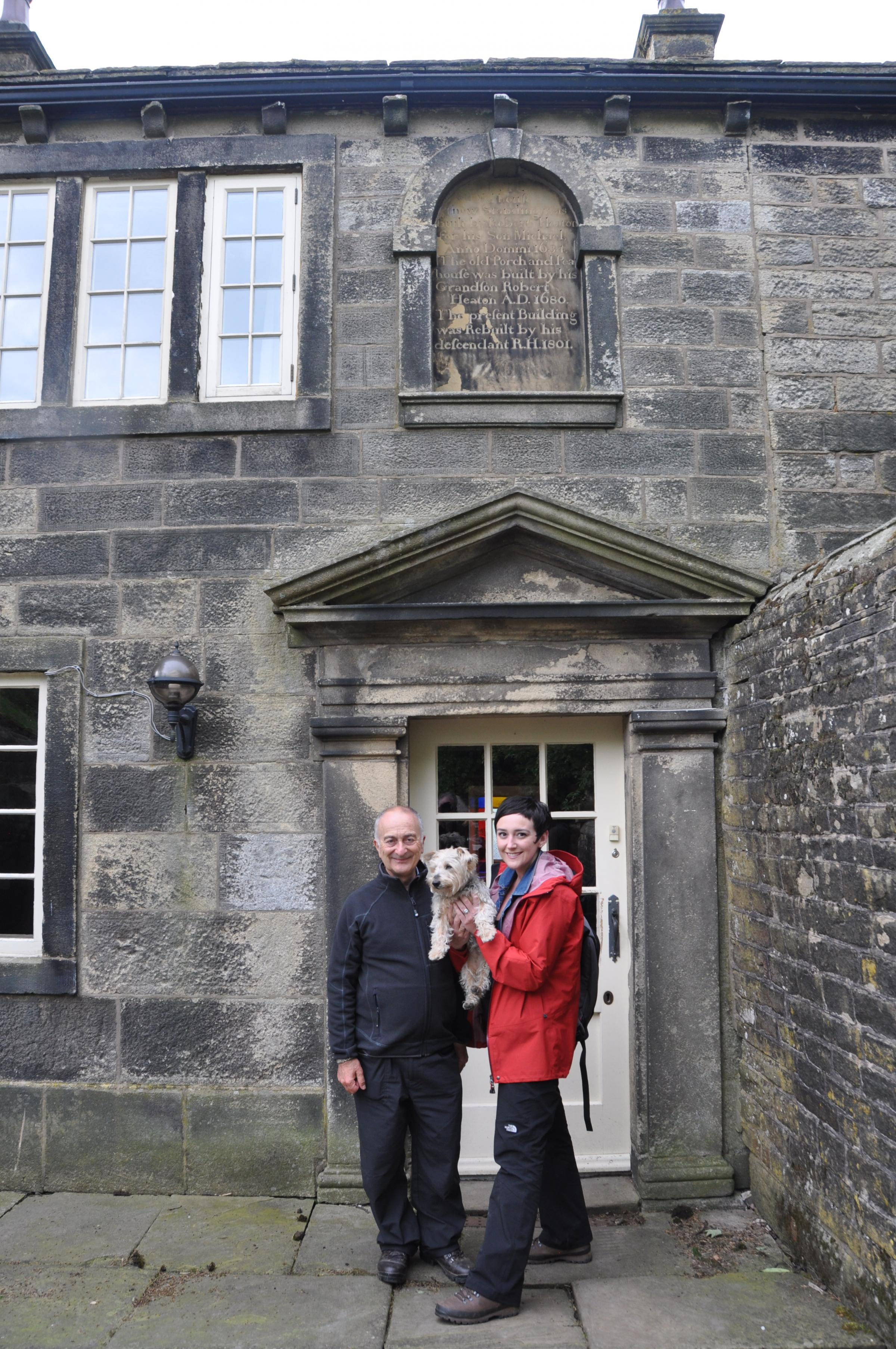 Sir Tony Robinson, his wife Louise, and their dog Winnie outside Ponden Hall