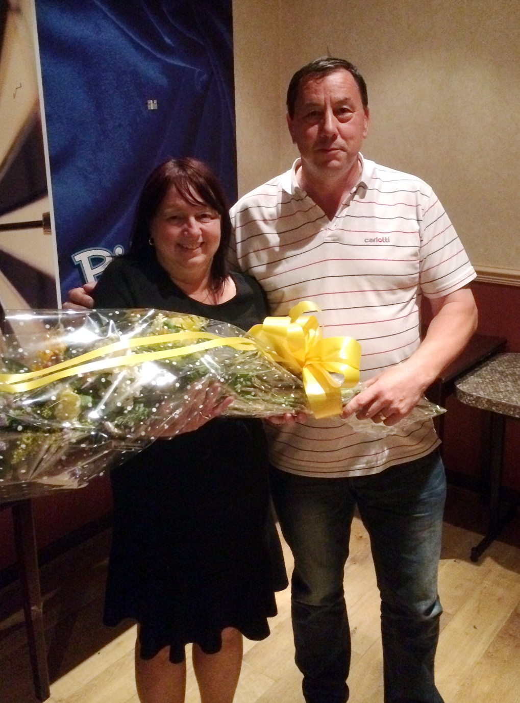 Kath Rickaby receives a gift from Long Lee president Eddie Pressland