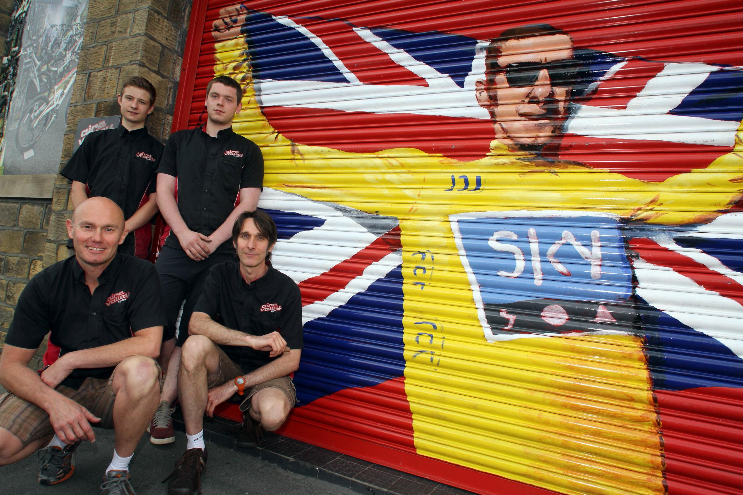 Champion cyclist Bradley Wiggins adds patriotic cheer to facade of Keighley bike shop