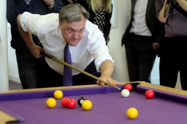 Keighley News: Ed Balls plays pool during his Keighley visit