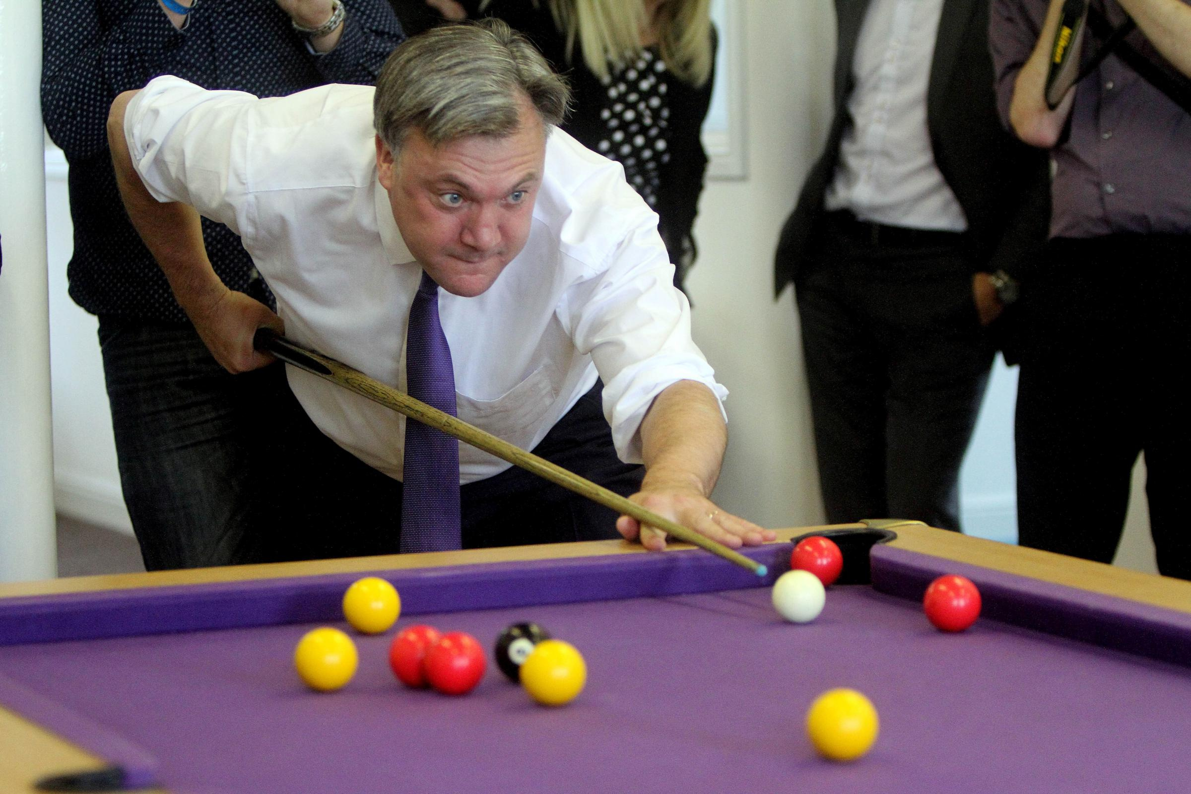 Ed Balls plays pool during his Keighley visit
