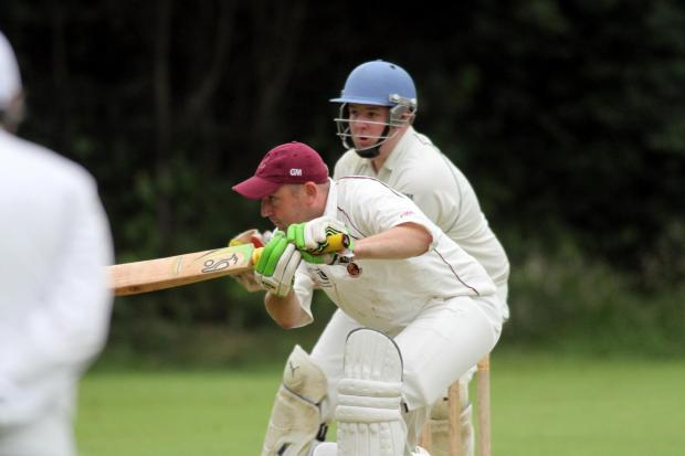 Keighley News: Opener Wayne Exley  gets down to it for Ingrow in their victory at Glusburn