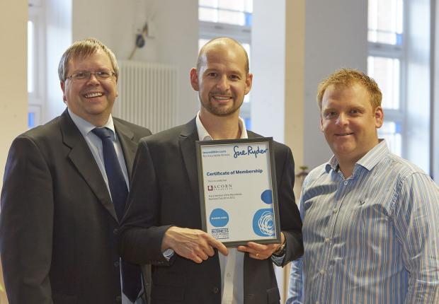 From left,  Acorn Stairlifts company secretary Dave Belmont and European operations manager Nick Wilson receive the Manorlands Business Club certificate from Sue Ryder regional fundraiser Andrew Wood