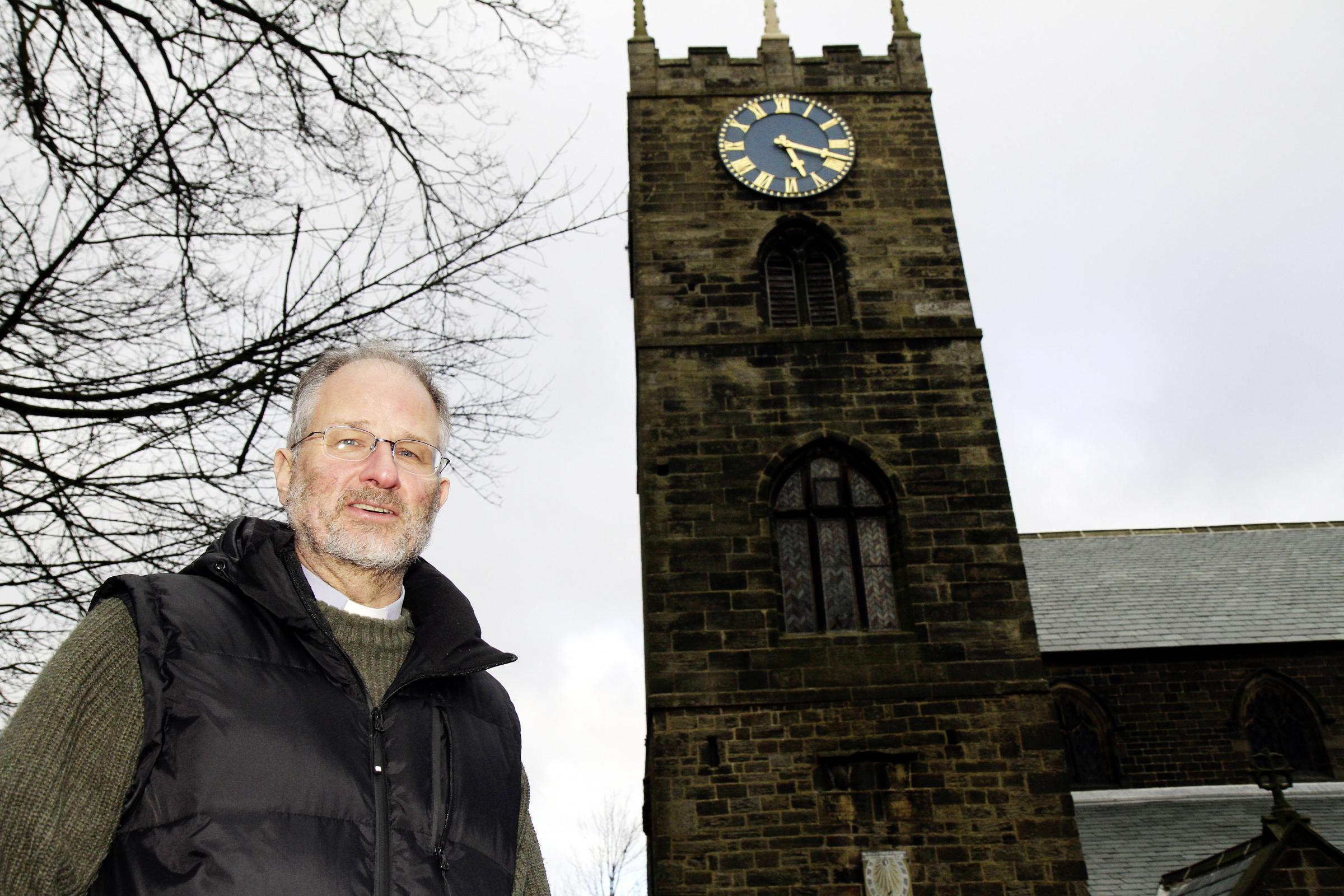 The Rev Peter Mayo-Smith outside Haworth Parish Church