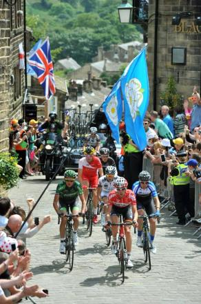 Tour competitors make their way up Haworth Main Street
