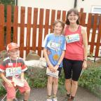 Keighley News: Pictured after finishing the Tour de  Riddlesden fun run are, from left, Joshua, Zac and Elspeth Cansdale.