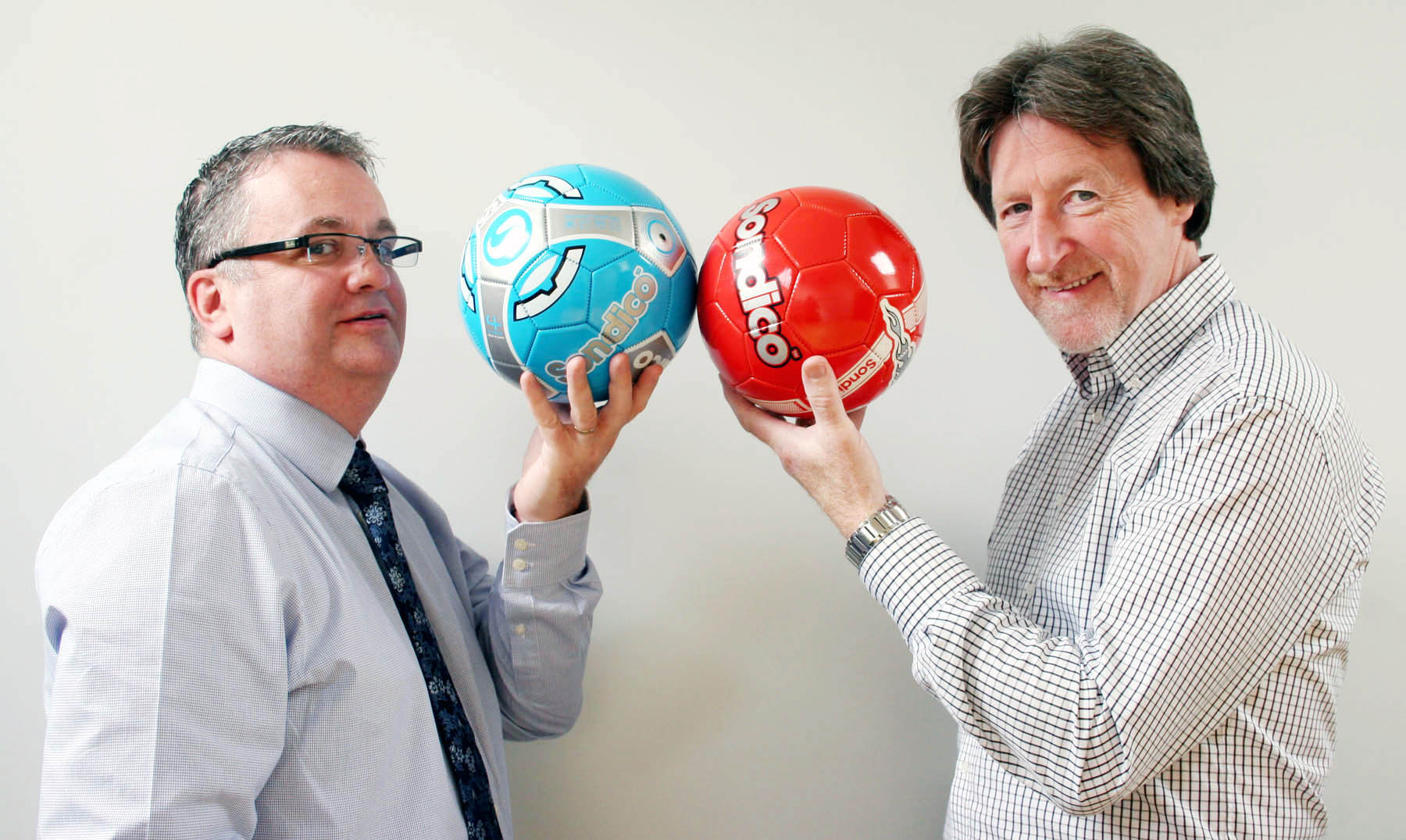 EYE ON THE BALL: Bradford & District Keybury Junior League secretary and treasurer Peter Walshe, left, and Frank Gee, managing director of sponsor Keybury Fire and Security