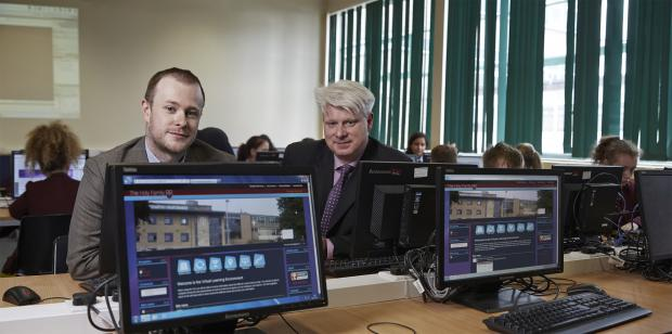 Keighley News: From left, Daniel Holmes, LDD consultancy services manager, and Webanywhere customer services manager, Simon Smith, in the IT suite at Holy Family