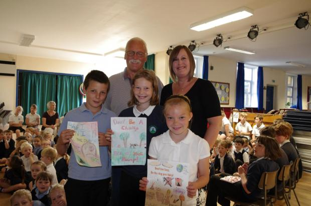 Cowling Primary School pupils Harry Rowe, Mollie White, and Holly Whitaker had the winning designs of a poster competition highlighting the issue of dog fouling. Village lengthsman David Hitchcock and Rachel Jackson, chair of the Recreation Ground Managem